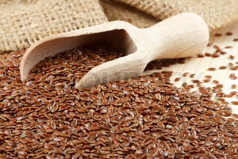 linseed, flax seeds, wooden scoop, sack